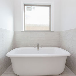 Freestanding tub and master bath design by Frantz Gibson Construction